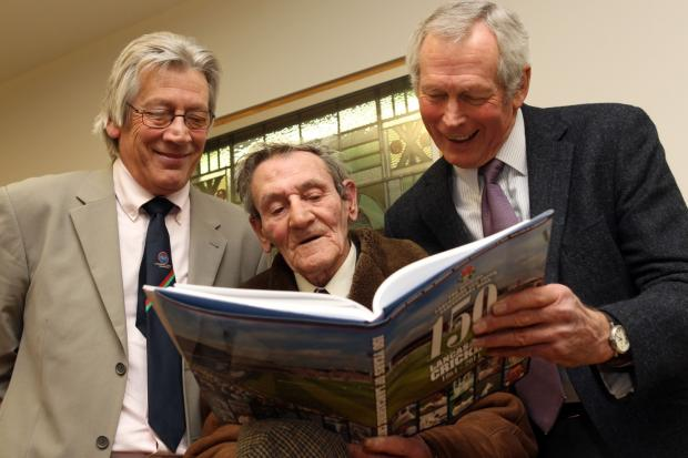 Pictured are former cricketers, Roger Tattersall, Geoff Clayton and Jim Cumbes with the 150th Anniversary book