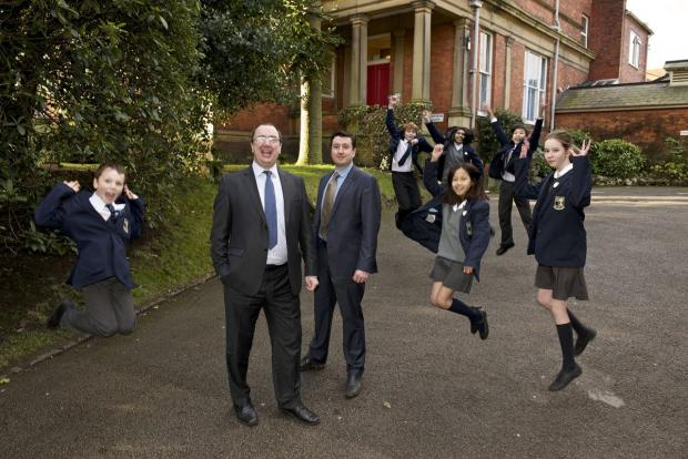 Delighted pupils with Lee Bergin, headmaster at North Cestrian (centre left) and deputy head Matthew Bell