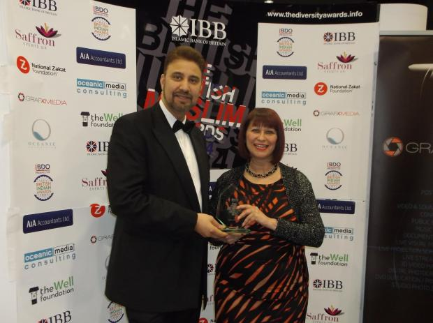 Afzal and Heather with the award