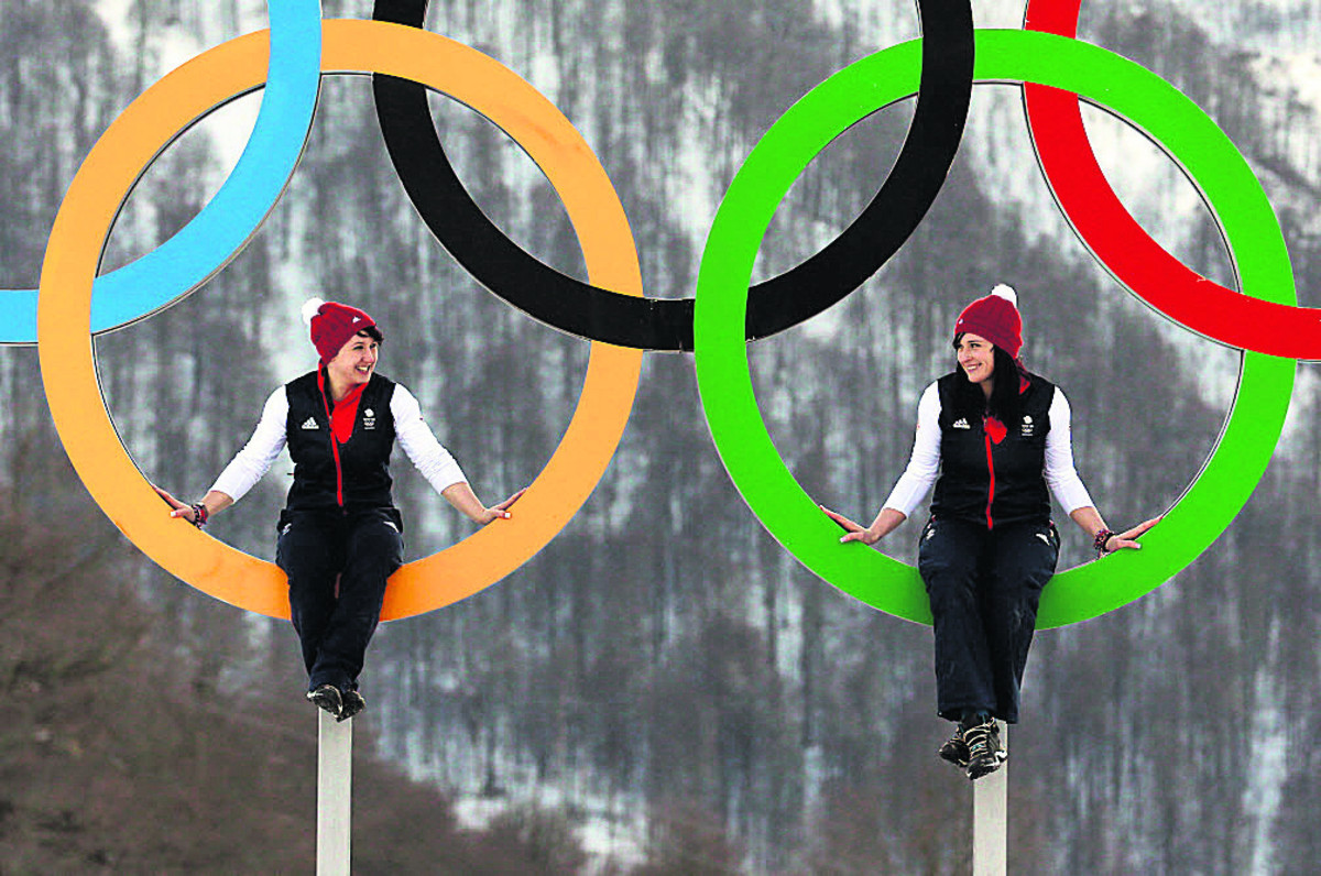 Rebekah (left) and Paula Walker (right) pose in the Olympic Rings in the athletes' village in Sochi earlier this week.Photo: Andrew Milligan/PA Wire