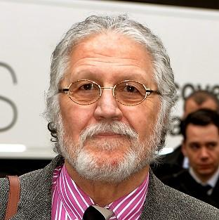 DJ Dave Lee Travis arrives at Southwark Crown Court in London, where he is accused of 13 counts of indecent assault and one count of sexual assault in 2008