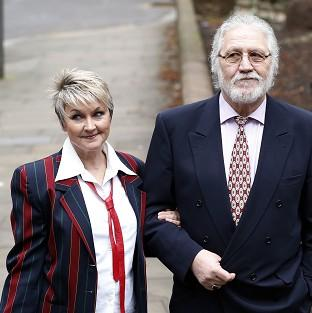 Messenger Newspapers: Former disc jockey Dave Lee Travis arrives at Southwark Crown Court with his wife Marianne.
