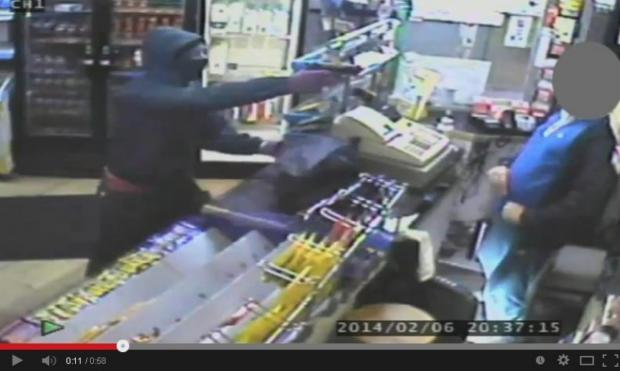 VIDEO: Gunman robs Urmston shop