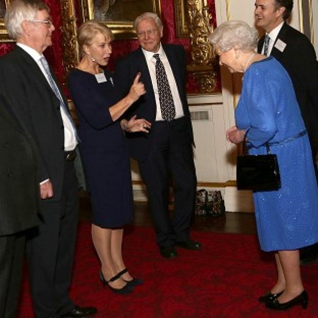 Messenger Newspapers: Queen Elizabeth II (right) meeting Dame Helen Mirren, as Sir David Attenborough (third left) looks on, during a Reception for the Dramatic Arts, at Buckingham Palace, London.
