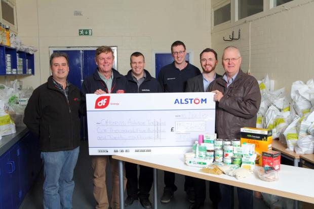 L to R: Jose Lopez, DF, Pat Cole from Sisk and sons, Joe Grimes from Barhale, Ross Lenihan from ESB, and Rainer Lueoend, Alstom present the cheque to Dale Maskell Citizens Advice Trafford second from right