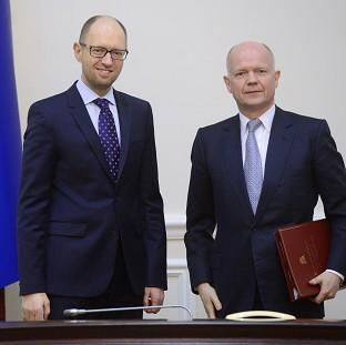 Messenger Newspapers: Ukrainian Prime Minister Arseniy Yatsenyuk, left, and British Foreign Secretary William Hague