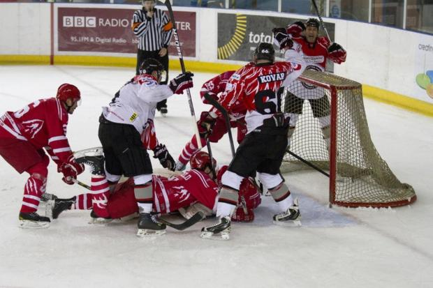 Phoenix's Robin Kovar, Tony Hand and James Archer celebrate the opening goal against Swindon Wildcats - by Andrew Sobutta