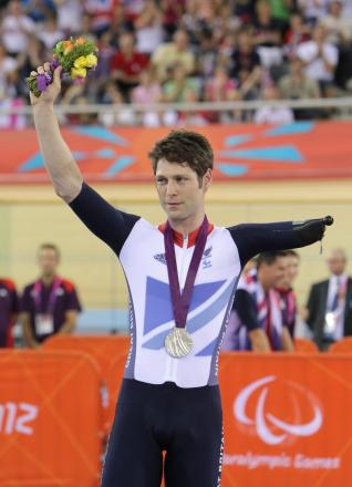 Paralympic cycling medallist Jon-Allan Butterworth bags an award