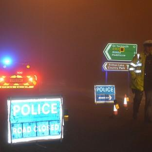 Messenger Newspapers: Police man a road block in Gillingham, near Beccles, Norfolk, as emergency services are attending a helicopter crash in Norfolk, police said.