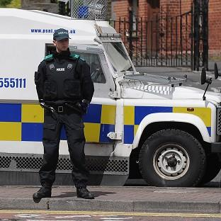 Messenger Newspapers: An explosive device was thrown at a police vehicle in west Belfast