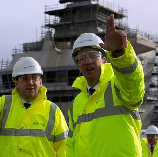 Labour leader Ed Miliband, right, visits Rosyth Dockyar