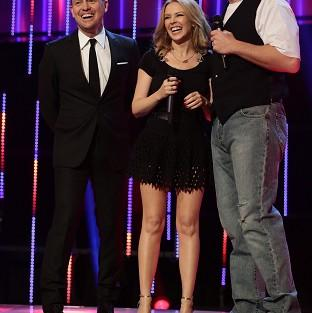 Messenger Newspapers: Jason Donovan, Kylie Minogue and David Walliams on stage for BBC Sport Relief 2014 (PA/BBC)