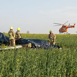 Messenger Newspapers: Emergency services at the scene of a plane crash in a field off the A414 near Ongar, Essex (PA/ Essex County Fire and Rescue Service)