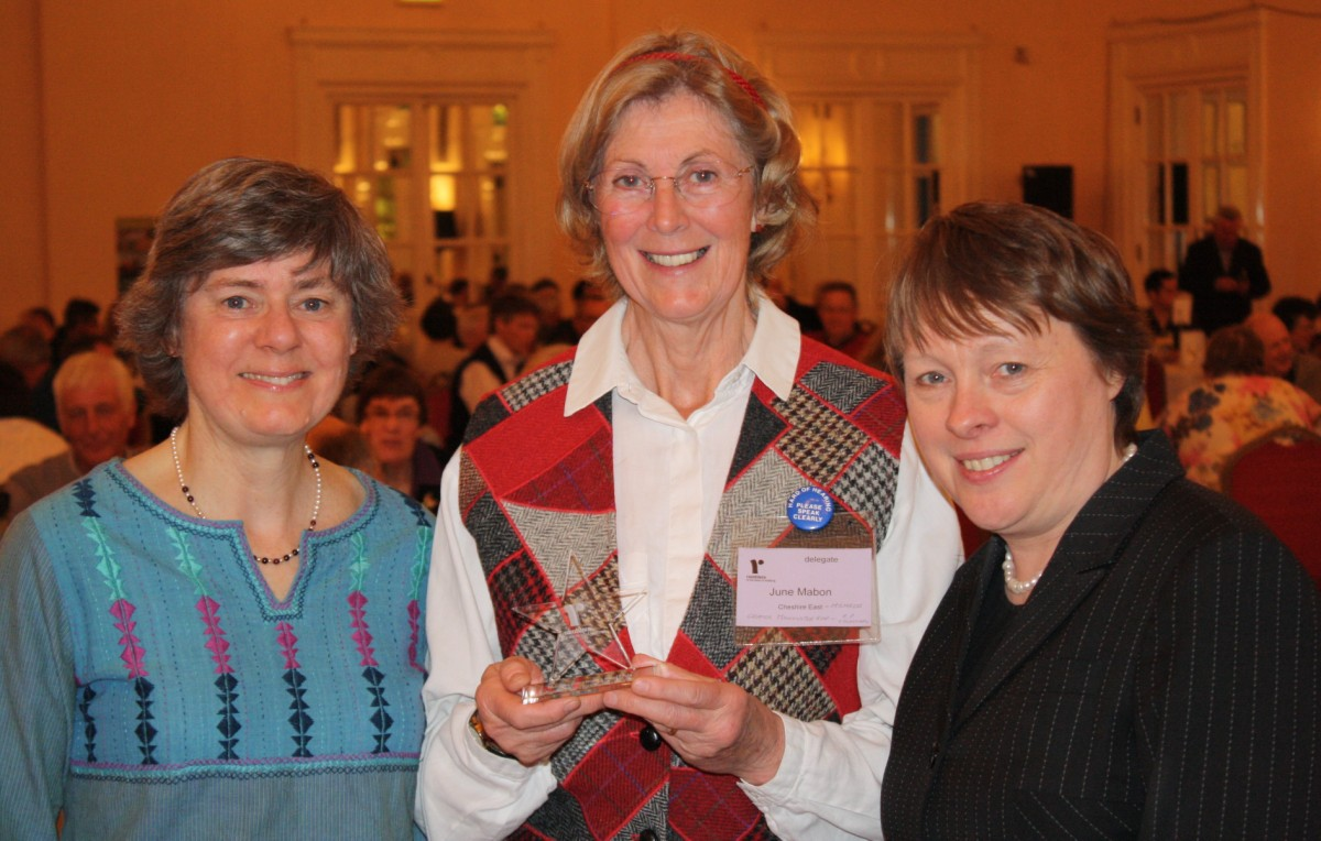 (centre) June Mabon, group footpath secretary of Trafford Ramblers, receives the Protecting Where We Walk Award from (left) Kate Ashbrook, president of the Ramblers and (right) Shadow Secretary of State Maria Eagle