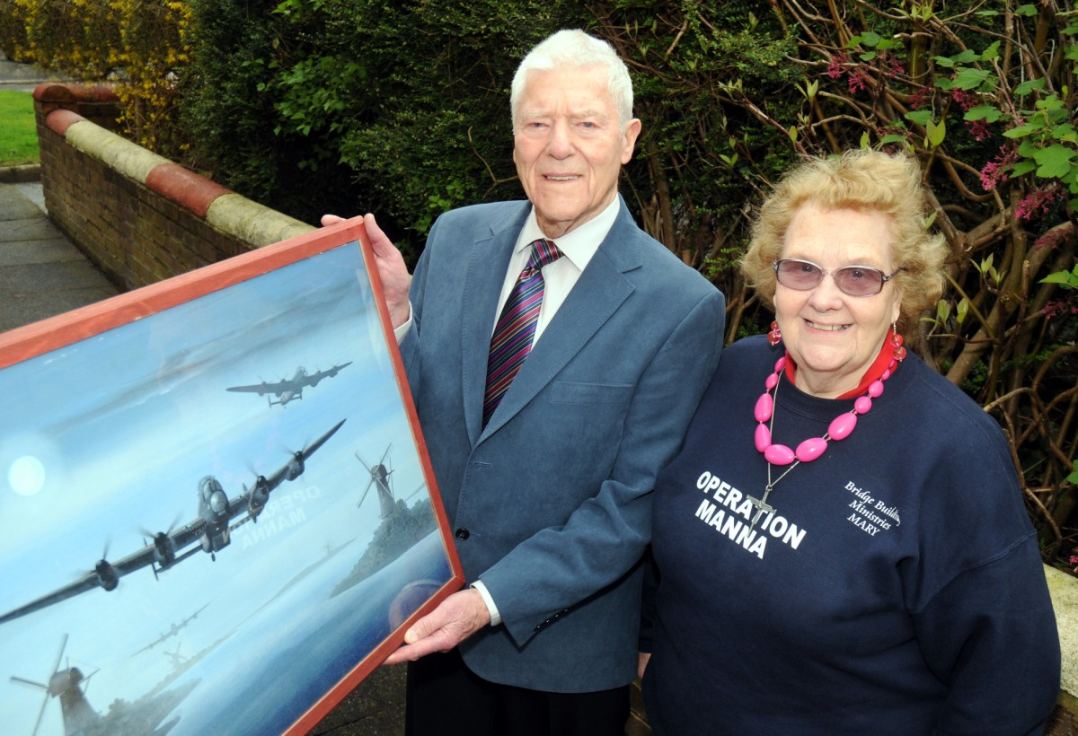 Frank Tolley and Mary Blackburn with the pencil drawing of an Avro Lancaster b