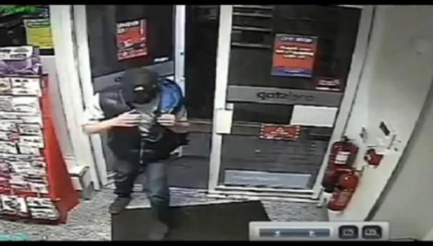 Police release footage of tattooed robber who held up Flixton convenience store