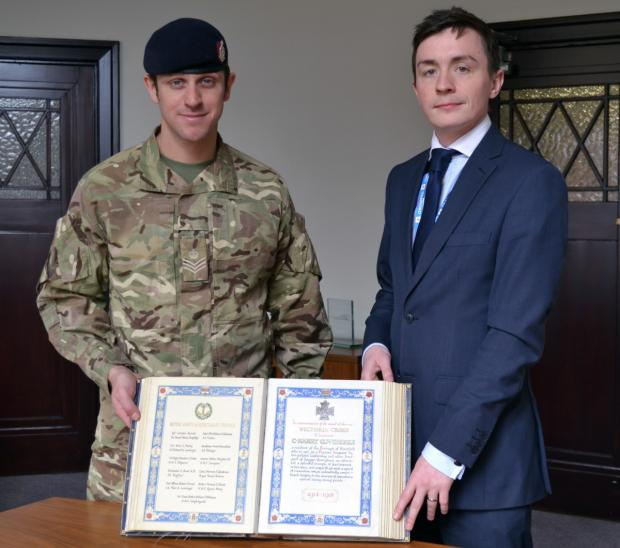 Cllr. Anstee and Staff Sgt Matt Spruce of the 207 Field Regiment with the Stretford book of remembrance