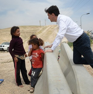 Miliband slams West Bank building