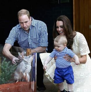 Messenger Newspapers: The Duke and Duchess of Cambridge and Prince George of Cambridge look at a Bilby called George at Taronga Zoo in Sydney (PA)