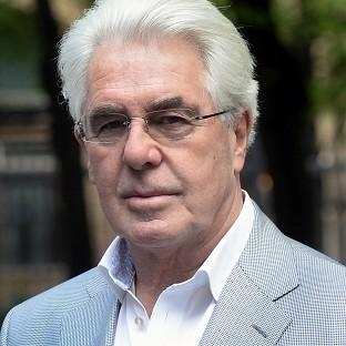 Publicist Max Clifford arrives at Southwark Crown Court in London