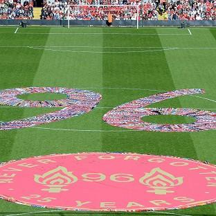 Fans' scarves make up a 96, filling the centre circle before the Hillsborough 25th Anniversary Memorial Service at Anfield Stadium, Liverpo