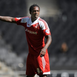 Swindon Town player Nile Ranger is facing questioning by the police