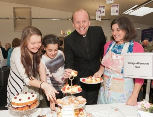 The vicar Roger Preece with Vintage Afternoon Teas at the last Business Fair in 2012