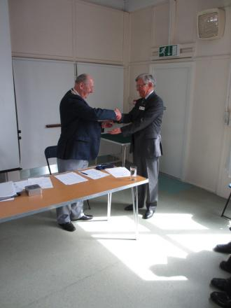 New chairman Geoff Flood thanking Ronnie Ballantyne for his services