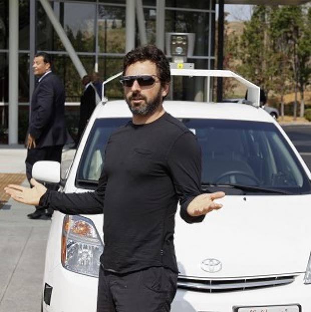Messenger Newspapers: Google co-founder Sergey Brin with a driverless car in Mountain View, California
