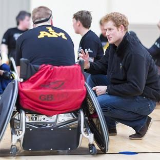 Messenger Newspapers: Prince Harry talks to veterans playing murder ball in wheelchairs during a visit to the Help For Heroes gym at Tedworth House in Tidworth, Wiltshire