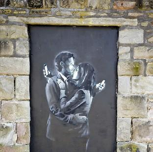 A piece of art entitled Mobile Lovers found on a wall near a boys' club in Bristol has been confirmed as a genuine Banksy