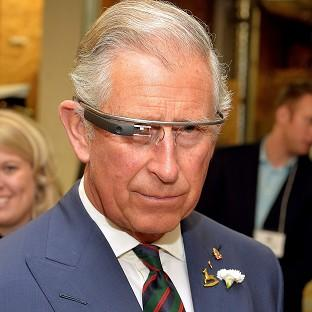 Messenger Newspapers: The Prince of Wales tries on Google Glass on the final day of his trip to Canada.