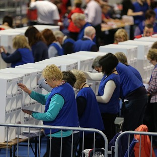 Staff at the King's Hall, Belfast, during counting for Northern Ireland's three seats in the European Parliamentary elections