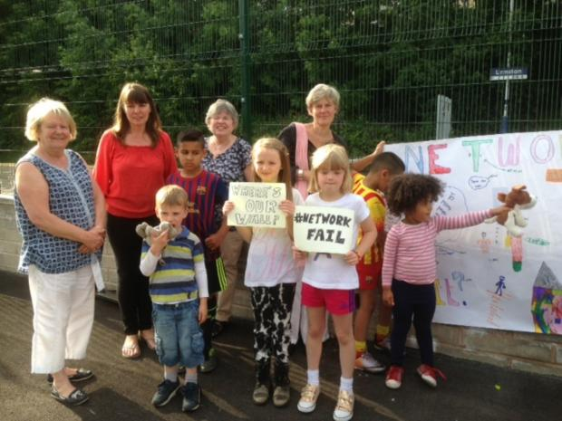 Kate Green and Walmsley Grove residents at the fence