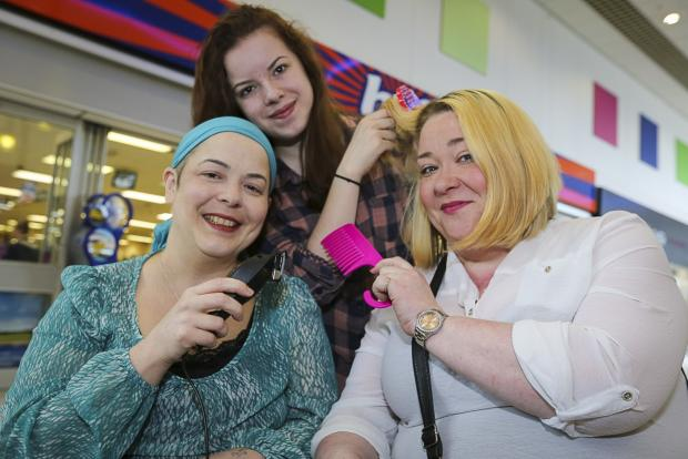 Tracy Donaghy (right) preparing for her fundraising head shave for her friend Becca Parkes and her duaghter Ambur Parkes