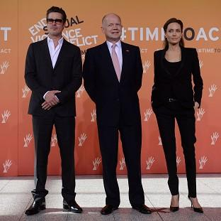 Messenger Newspapers: Foreign Secretary William Hague (centre), Brad Pitt and Angelina Jolie arrive at the End Sexual Violence in Conflict Summit at the Excel centre in east London.