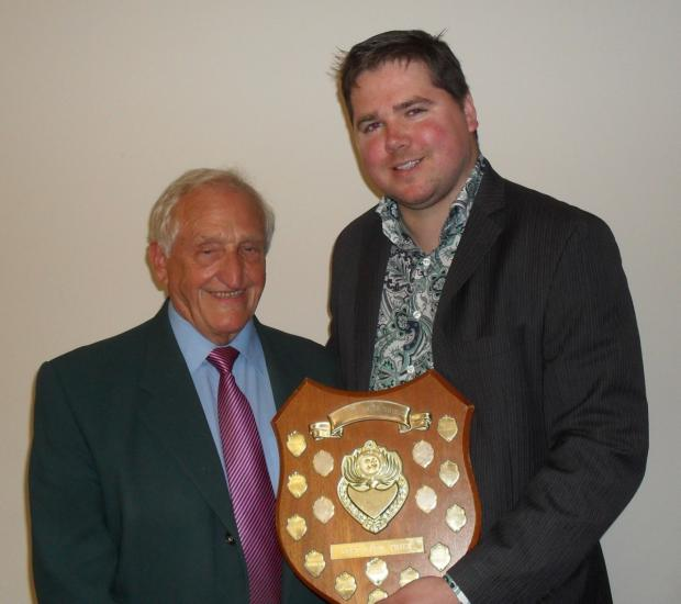 He is receiving the shield from sponsor of the shield and Life Member of the Society John Smith - left)