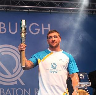 Messenger Newspapers: Alex Arthur carried the Glasgow 2014 Queen's Baton on to the stage as it ended the day in Edinburgh (David Cheskin for Glasgow 2014)