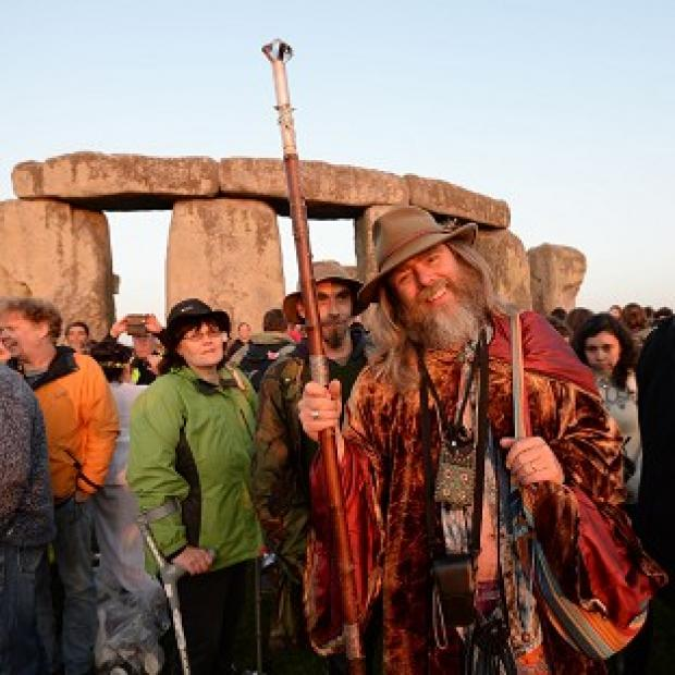 Messenger Newspapers: Crowds gather at dawn amongst the stones at Stonehenge in Wiltshire for the Summer Solstice.