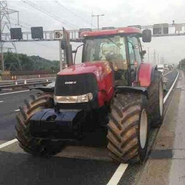 Messenger Newspapers: A red tractor has been seized after it was spotted being illegally driven on the M6 motorway. (Photo taken from the Twitter feed of @CMPG, the Central Motorway Police Group)
