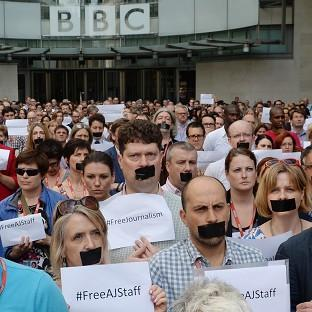 Messenger Newspapers: BBC staff and journalists protest outside New Broadcasting House in London by taping up their mouths about the imprisonment in Egypt of journalists Peter Greste, Mohamed Fahmy and Baher Mohamed.