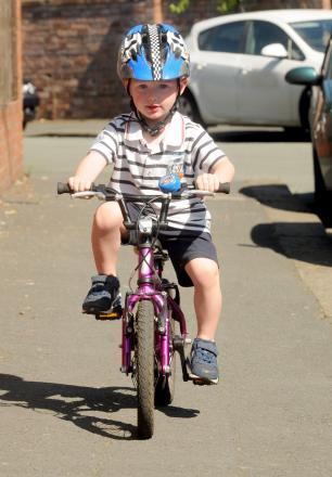 Could he be a record breaker? Sale toddler rides bike without stabilisers at two-years-old