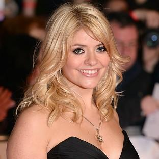 Pregnant TV presenter Holly Willoughby says she is determined to work until she goes into labour