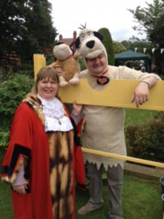 The Provost of Altrincham, Denise Laver and Rev Danny Crosby in the stocks