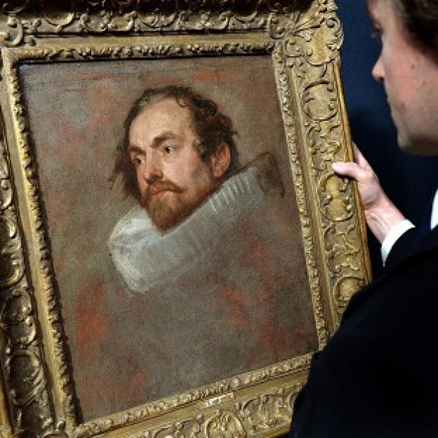 Messenger Newspapers: A member of Christie's staff looking at a portrait by Sir Anthony Van Dyck, which failed to sell at auction.