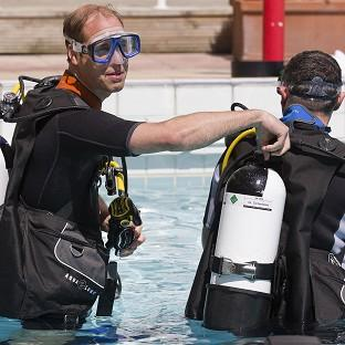 Messenger Newspapers: The Duke of Cambridge makes safety checks with BSAC chairman Eugene Farrell before scuba diving with British Sub-Aqua Club members at a swimming pool in London