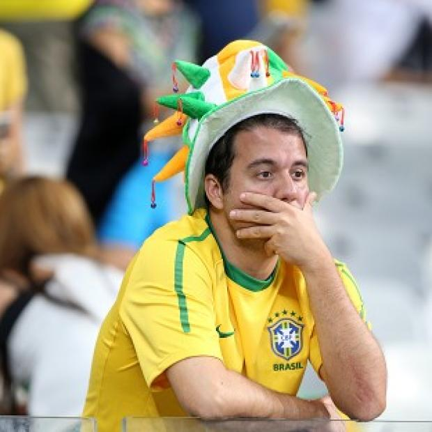 Messenger Newspapers: Brazil fans were dejected after their team's humbling at the hands of Germany in the World Cup semi-final