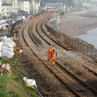 Engineers from Network Rail carry out repair work to the Great Western Main Line in Dawlish, which was damaged during winter storms last month