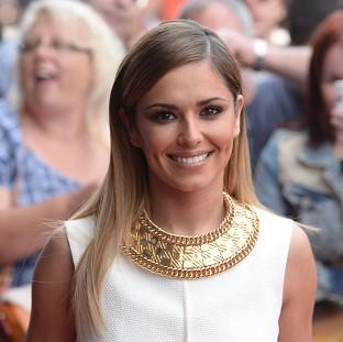 Cheryl Cole is celebrating her fourth solo number one - and her ninth overall