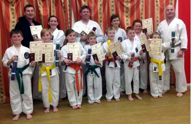 Successful students, from left,  Jack Tatham, Emily Roberts, Milley Carey, Harvey Larkin, Jack Mulligan, Harry Bradshaw, Jacob Hamey and James Goode. Adults: Vicky Goode and Mark Larkin. They are pictured with Sensei Shipton and Sensei Tarrant